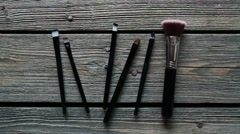 Brush make-up on the table. Makeup artist takes the brush Stock Footage