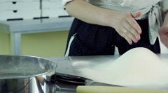 Young woman doing deepening in the flour and breaking two eggs in the flour. HD Stock Footage