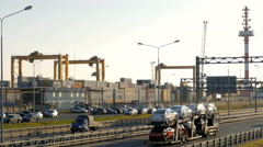 The container terminal near to a highway where cars go. St.-Petersburg, aerial Stock Footage