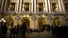 Visitors entering Opera National de Paris, waiting for evening performance Stock Footage