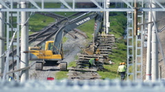 Construction excavator and workers working on the railroad. Saint-Petersburg Stock Footage