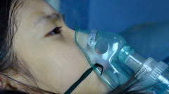 Close up of Asian girl treatment of respiratory tract inhalation on her face. Stock Footage