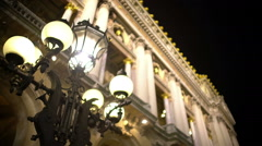 Antique street light near illuminated historic building, architecture and art Stock Footage