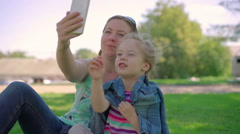 Mum with a small daughter do selfie Stock Footage