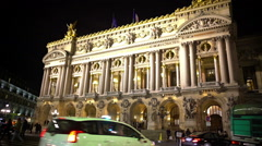 Heavy street traffic in front of Opera National de Paris, active urban life Stock Footage