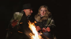 Romantic date around the campfire Stock Footage