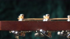 Tuning pegs of acoustic guitar. Tuning or adjustment concept. 4K close up dolly Stock Footage