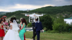 Quadrocopter on the background of people and honeymooners Stock Footage