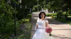Bride in the park Stock Footage