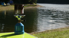 Camp gas bottle in campsite near to the lake Stock Footage