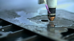 CNC plasma cutter that is cutting out metal objects in a heavy industry factory Stock Footage