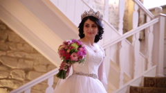 Bride standing on the stairs and sees a bouquet Stock Footage