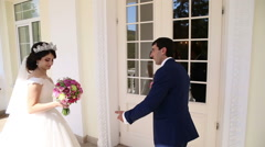 Bride invites the bride to enter the house Stock Footage