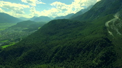 Nature landscape wide valley mountains range scenery green forest sky aerial Stock Footage