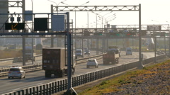 Several trucks and cars driving on the highway at the sunset. Saint-Petersburg Stock Footage