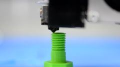 Macro 3D printer is the model of the screw thread on the green blurry background Stock Footage