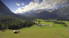 Aerial valley wide landscape Austria nature green grass pasture mountains sky Stock Footage