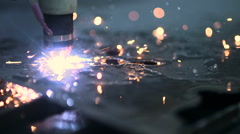 Plasma laser cutting metal sheet with sparks Stock Footage