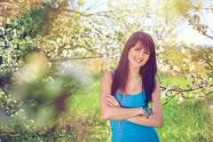 Woman smiling standing in blooming trees in spring Stock Photos