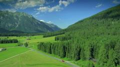 Beautiful landscape Austria Alps green grass pasture mountain sky sunny aerial Stock Footage