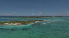 Motor boat sails in Caribbean waters. Aerial view. Exuma, Bahamas Stock Footage