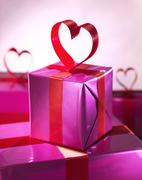 Red love heart gift box Stock Photos