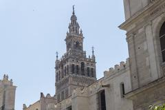 Bell tower Giralda, former minaret of Cathedral church, Seville, Spain Stock Photos