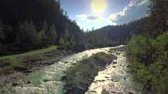 Aerial stream sun reflection forest beautiful nature Austrian Alps creek sunny Stock Footage