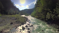 Aerial forward motion mountain stream forest beautiful nature Alps brook sunny Stock Footage