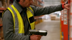 Male worker using barcode scanner Stock Footage