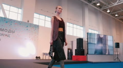 Fashion show. Female models in dresses go on the catwalk Stock Footage