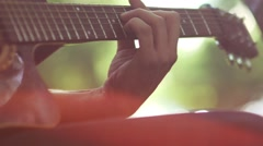 Slow motion. Guitarist playing a musical instrument Stock Footage