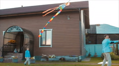 Man Showing His Family How to Fly a Kite Stock Footage
