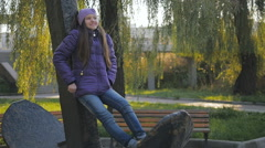 Beautiful teen girl standing in the autumn park. delayed filming. soft sunlight Stock Footage