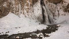 High waterfall in the tract Gil-Su high in the Caucasus mountains in winter Stock Footage