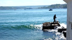 Young man fishing port of Sevastopol. Crimea. Stock Footage