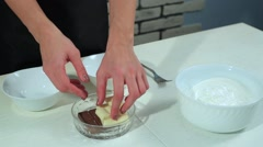 Woman breaks the chocolate. To cook the meringue for donuts Stock Footage