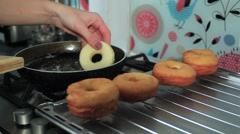 Frying donuts in a kitchen, detail of a kitchen, sweet dessert Stock Footage