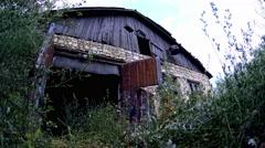 Abandoned grassy farm gate Stock Footage