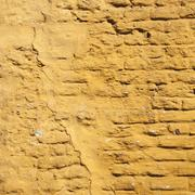 Square part of ochre yellow washed wall Stock Photos