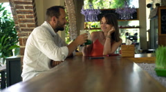 Happy couple raising toast to camera and drinking beverages in cafe, 4K Stock Footage