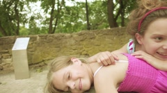 Two little girls playing in Riga, Latvia Stock Footage