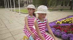 Two little girls playing in Kaunas, Lithuania Stock Footage