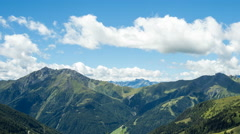 Clouds over alpine mountains time lapse Stock Footage