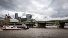 The River Thames, Cannon St Railway Bridge and The City of London, England Stock Footage