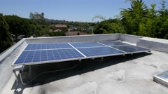 Solar panels on roof of house Stock Footage
