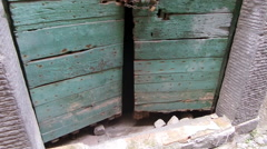 Old cellar door in wood locked with chain in Bracciano, Lazio, Italy. Stock Footage