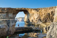 GOZO, MALTA - JUNE 6: Tourist visiting the Azure Window, a famous stone arch, Stock Photos