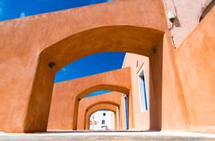 Gallery. Orange arches and blue sky Kuvituskuvat