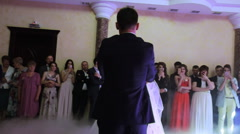 Beautiful young newlyweds dancing their first dance shrouded by white fume Stock Footage